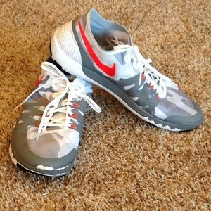 Men's Nike Free Trainer tennis shoes.